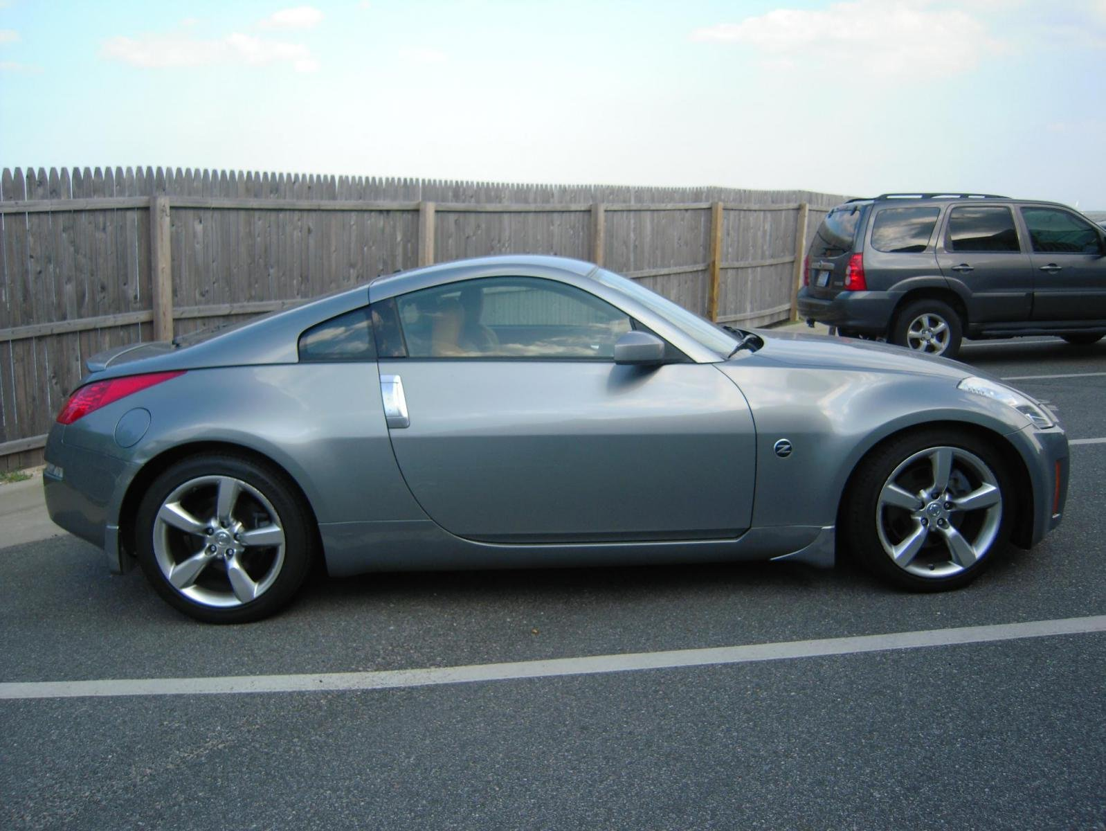 Just picked up my 06 350Z touring Coupe MT  Nissan 350Z Forum